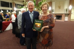 Author Martin J. McFie presenting Lois Masteller with his new release dedicated to Bob