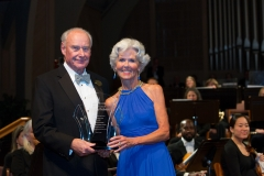 Board Chairman Jim Willard presenting Achievement Award to President Mary M. Briggs
