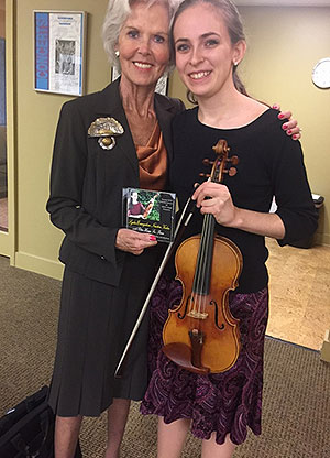 Youth Concerto competitor, Lydia Evangeline Newton, performs for Mary Briggs and the HHSO Board of Directors.